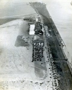 Aerial View from 1935 of Alameda Airport along the estuary and Southern Pacific Mole and Red Trains IRR tracks leading to wharf and ferry mole in distance, Alameda California, 1935.